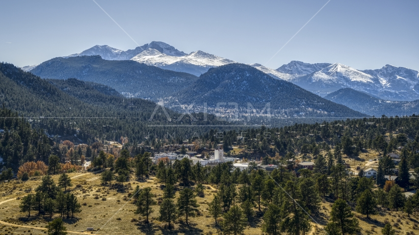 A small town with snowy mountains visible in the background in Estes Park, Colorado Aerial Stock Photos   DXP001_000216