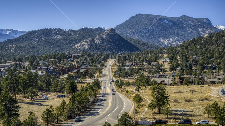 Cars on a road through the mountain town of Estes Park, Colorado Aerial Stock Photos | DXP001_000218