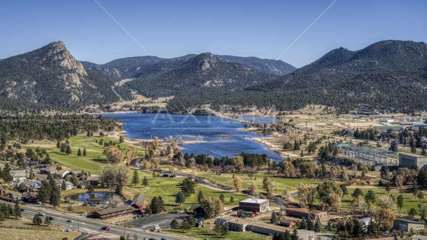 Golf course next to Lake Estes with mountains in the background in Estes Park, Colorado Aerial Stock Photos   DXP001_000220
