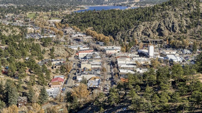 Shops on a road through Estes Park, Colorado Aerial Stock Photos   DXP001_000221