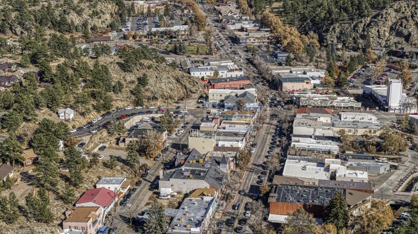 Shops lining a road through Estes Park, Colorado Aerial Stock Photos   DXP001_000223