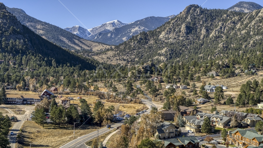 Rural homes by a road near rugged mountains, Estes Park, Colorado Aerial Stock Photos | DXP001_000227