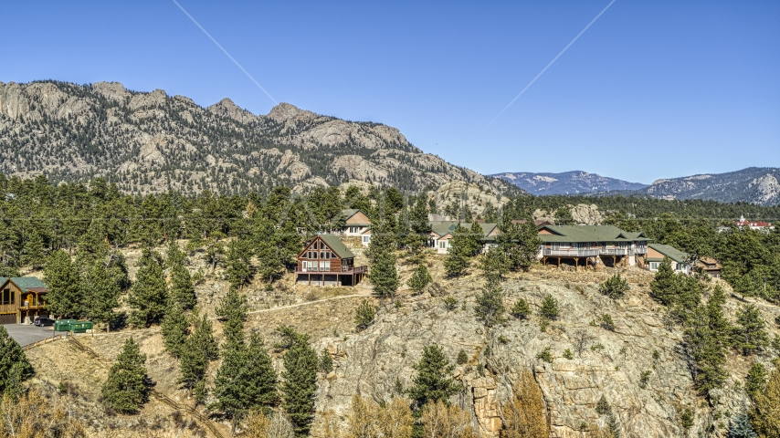 Rural hillside homes near rugged mountains, Estes Park, Colorado Aerial Stock Photos | DXP001_000229