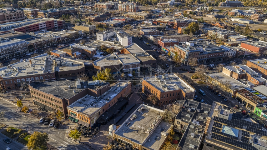 Brick office buildings and shops around a quiet intersection in Fort Collins, Colorado Aerial Stock Photos | DXP001_000232