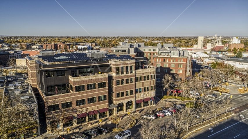 A brick office building beside a quiet street in Fort Collins, Colorado Aerial Stock Photos | DXP001_000237