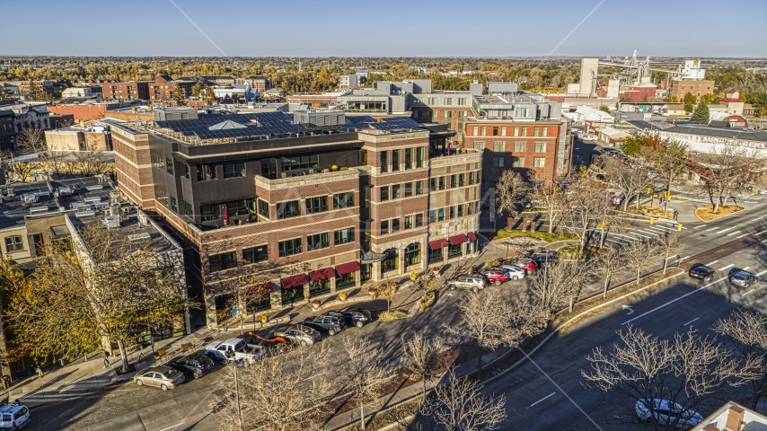A brick office building by a quiet street in Fort Collins, Colorado Aerial Stock Photos   DXP001_000238