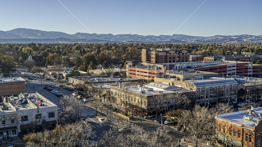 Shops and office buildings beside a quiet street in Fort Collins, Colorado Aerial Stock Photos | DXP001_000240