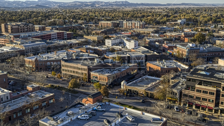 A view across town at brick office buildings and shops in Fort Collins, Colorado Aerial Stock Photos | DXP001_000246