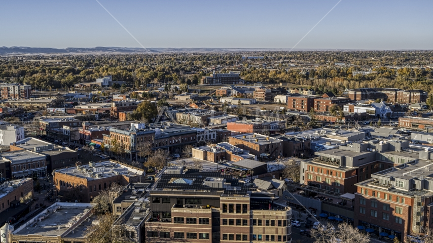 A view across the tops of brick office buildings and small shops in Fort Collins, Colorado Aerial Stock Photo DXP001_000247 | Axiom Images
