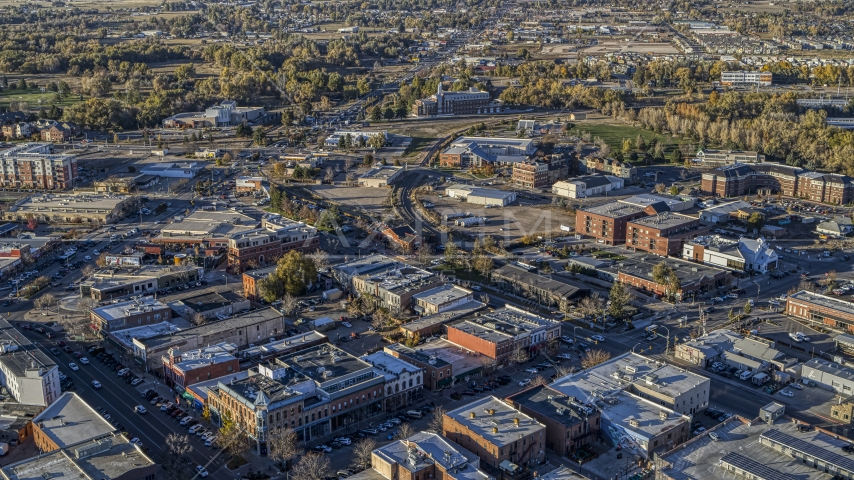 Brick office buildings and small shops near railroad tracks in Fort Collins, Colorado Aerial Stock Photos | DXP001_000248