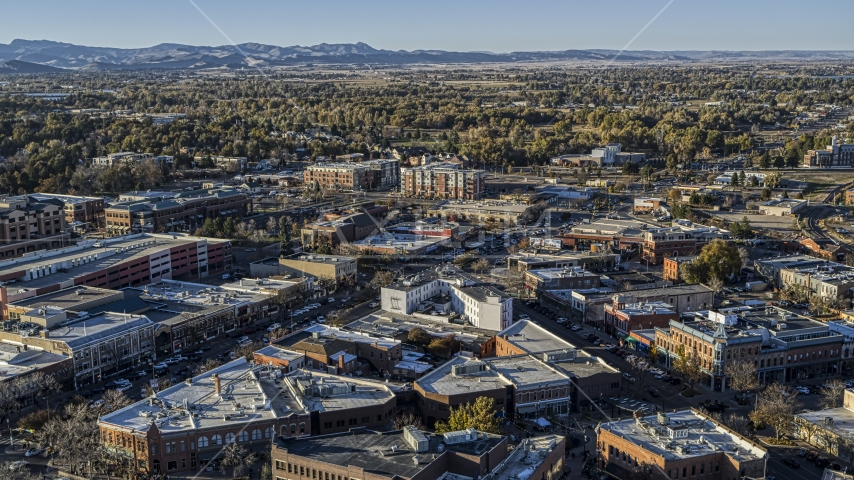 Shops lining a busy town road in Fort Collins, Colorado Aerial Stock Photos | DXP001_000251