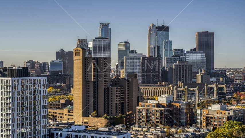 The city skyline's skyscrapers at sunrise seen from treetops in Downtown Minneapolis, Minnesota Aerial Stock Photo DXP001_000279 | Axiom Images