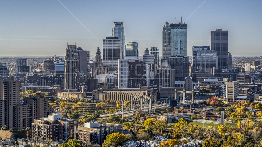 The city skyline's skyscrapers seen from near a condo complex at sunrise, Downtown Minneapolis, Minnesota Aerial Stock Photo DXP001_000283 | Axiom Images