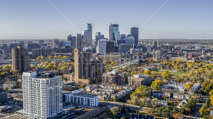 Condo complex in the foreground, city skyline's skyscrapers in the background at sunrise, Downtown Minneapolis, Minnesota Aerial Stock Photo DXP001_000285 | Axiom Images