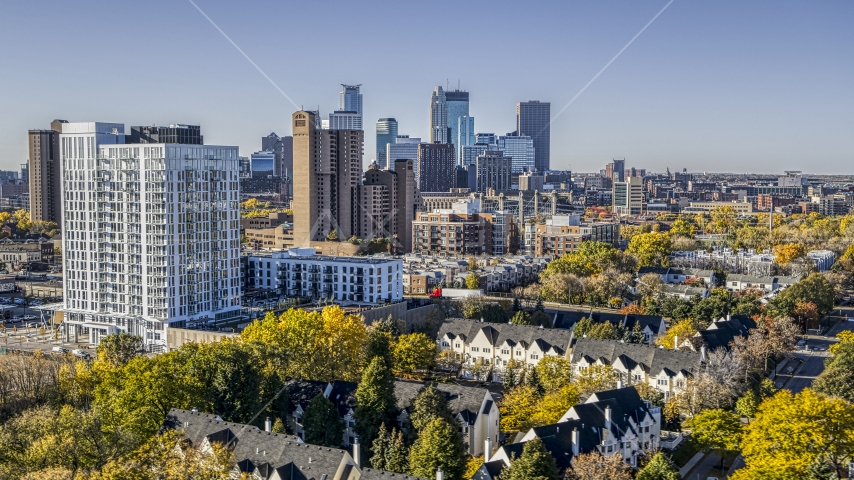 Apartment and condo complexes in the foreground, city skyline's skyscrapers in the background, Downtown Minneapolis, Minnesota Aerial Stock Photo DXP001_000286 | Axiom Images
