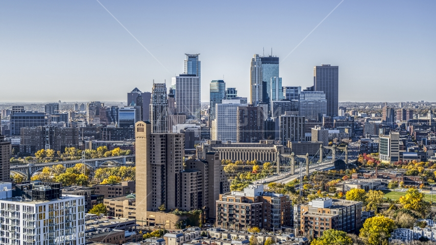 Apartment and condo complexes in the foreground, city skyline in the background, Downtown Minneapolis, Minnesota Aerial Stock Photo DXP001_000287 | Axiom Images