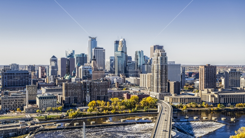 The city skyline seen from a bridge spanning the Mississippi River, Downtown Minneapolis, Minnesota Aerial Stock Photo DXP001_000291 | Axiom Images