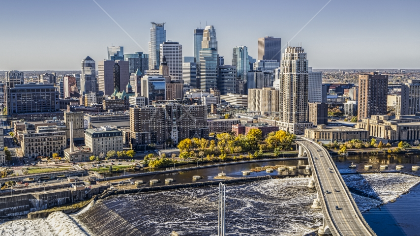 The city skyline on the opposite side of a bridge spanning the Mississippi River, Downtown Minneapolis, Minnesota Aerial Stock Photo DXP001_000294 | Axiom Images