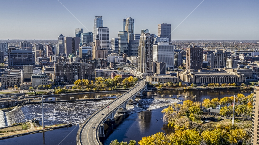 The city's skyline seen from a bridge spanning the Mississippi River, Downtown Minneapolis, Minnesota Aerial Stock Photo DXP001_000297 | Axiom Images