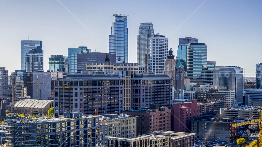 Office buildings with city skyline's skyscrapers in the background, Downtown Minneapolis, Minnesota Aerial Stock Photo DXP001_000302 | Axiom Images