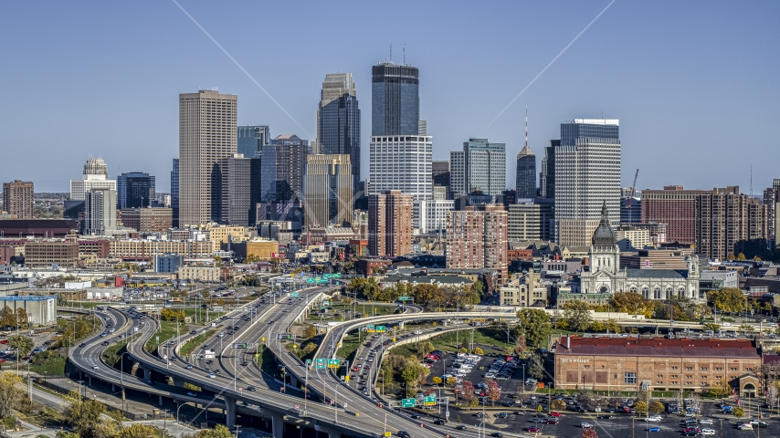 The city's skyline behind the I-394 freeway interchange with light traffic, Downtown Minneapolis, Minnesota Aerial Stock Photo DXP001_000313 | Axiom Images