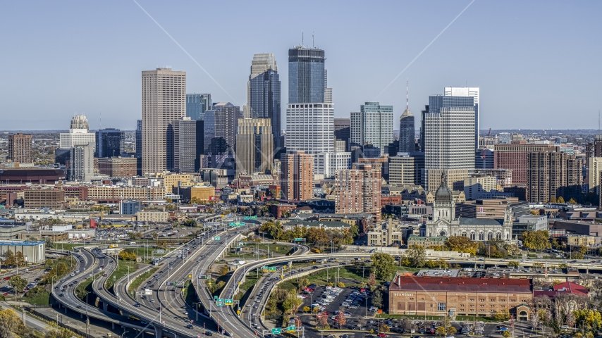 The city's downtown skyline behind the I-394 freeway interchange with light traffic, Downtown Minneapolis, Minnesota Aerial Stock Photo DXP001_000314 | Axiom Images
