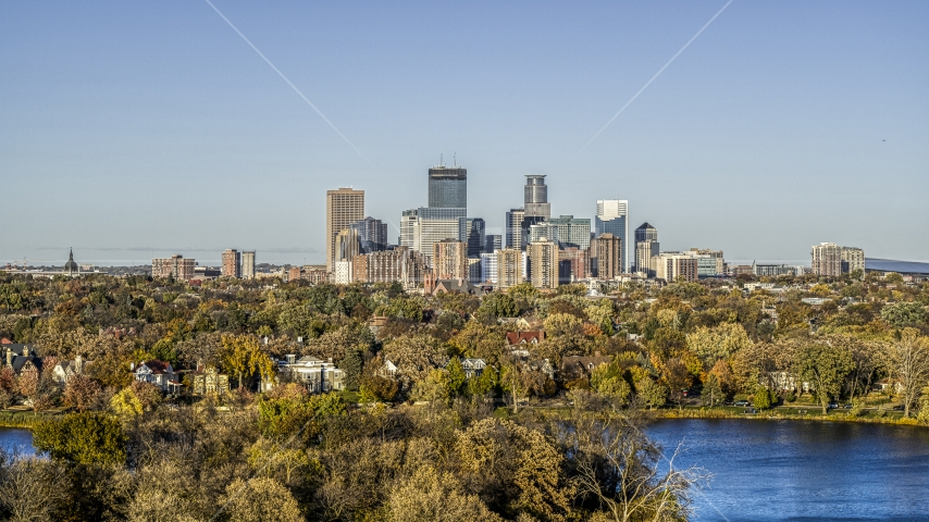 Lakefront neighborhoods and city skyline seen from Lake of the Isles, Downtown Minneapolis, Minnesota Aerial Stock Photo DXP001_000318 | Axiom Images