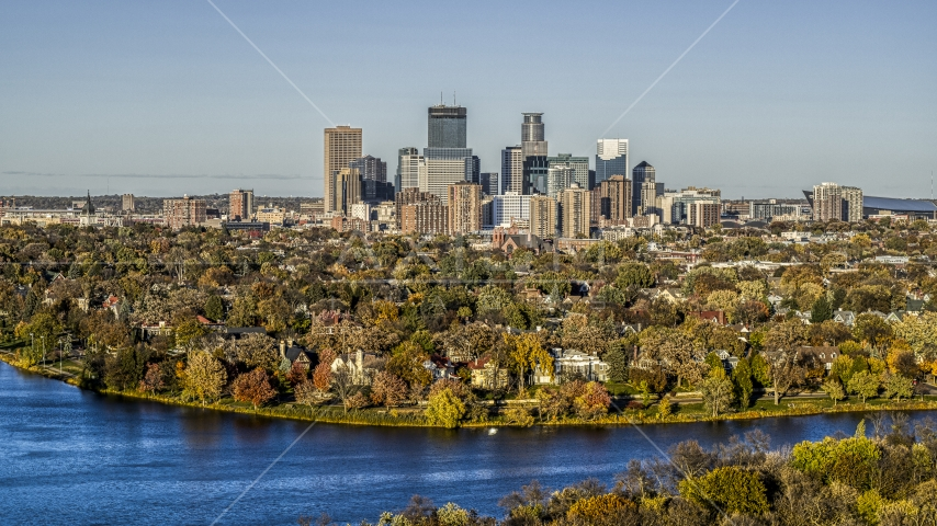 Lakefront homes and city skyline seen from Lake of the Isles, Downtown Minneapolis, Minnesota Aerial Stock Photo DXP001_000321   Axiom Images