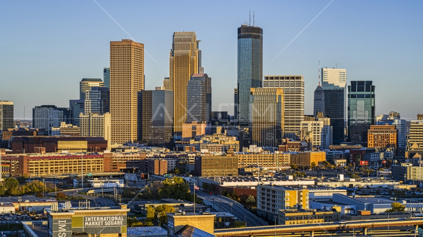 Giant skyscrapers of the city's skyline at sunset in Downtown Minneapolis, Minnesota Aerial Stock Photo DXP001_000324 | Axiom Images