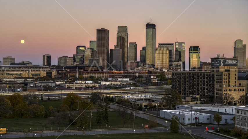 The moon in the sky beside the city's skyline at twilight in Downtown Minneapolis, Minnesota Aerial Stock Photo DXP001_000328 | Axiom Images