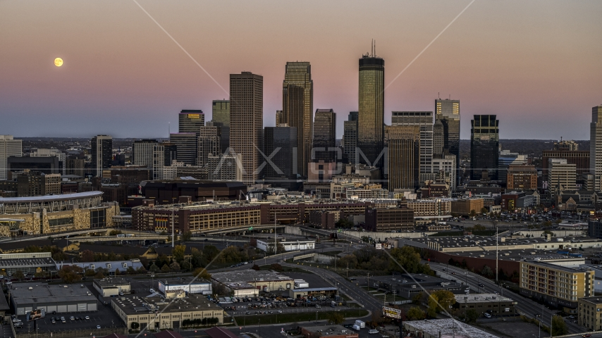 The moon in the sky near the city's skyline at twilight in Downtown Minneapolis, Minnesota Aerial Stock Photo DXP001_000329 | Axiom Images