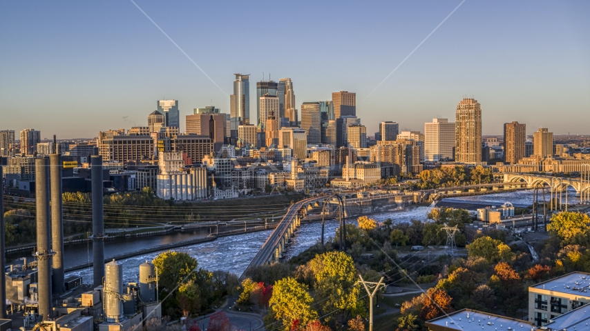 The downtown skyline across the river, seen from a bridge at sunrise, Downtown Minneapolis, Minnesota Aerial Stock Photo DXP001_000353   Axiom Images