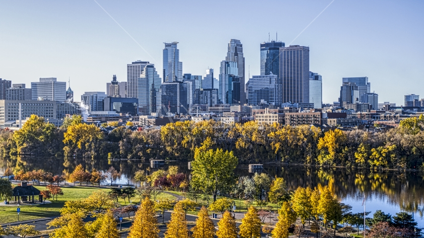 The city's skyline seen from the river lined with autumn trees, Downtown Minneapolis, Minnesota Aerial Stock Photo DXP001_000360 | Axiom Images