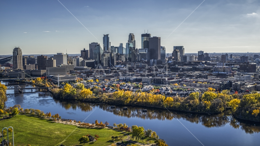 City skyline seen from the Mississippi River with fall trees, Downtown Minneapolis, Minnesota Aerial Stock Photo DXP001_000399 | Axiom Images