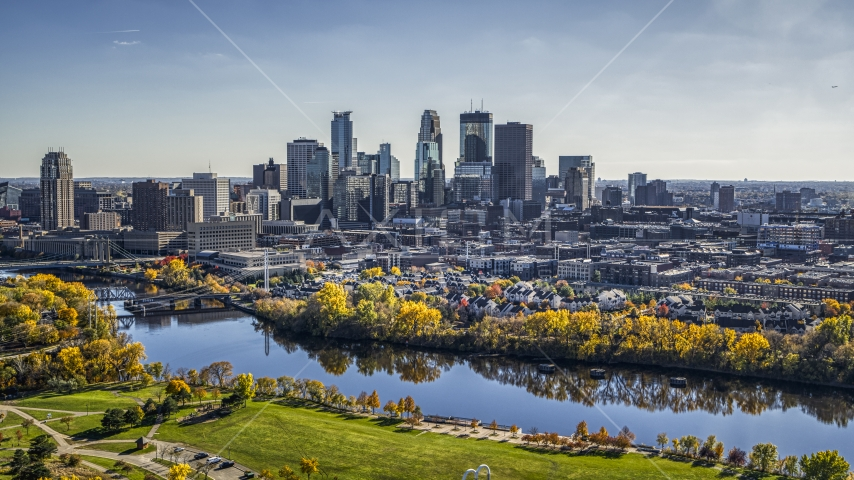 A view across the Mississippi River with fall trees at the city's skyline, Downtown Minneapolis, Minnesota Aerial Stock Photo DXP001_000403   Axiom Images