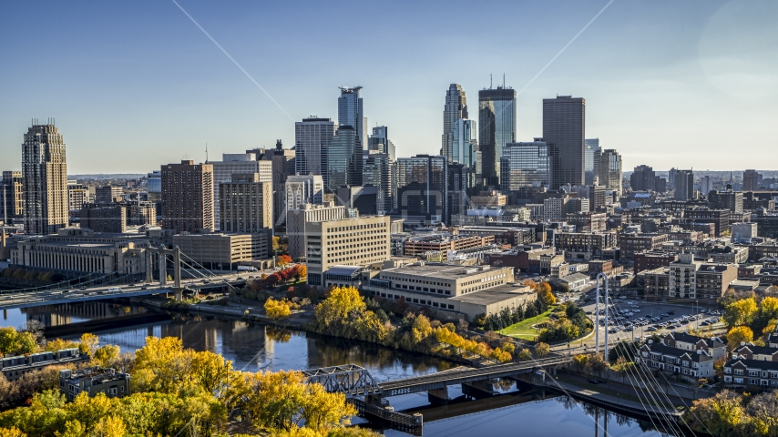 The towering skyline and bridges spanning the river, Downtown Minneapolis, Minnesota Aerial Stock Photo DXP001_000409 | Axiom Images