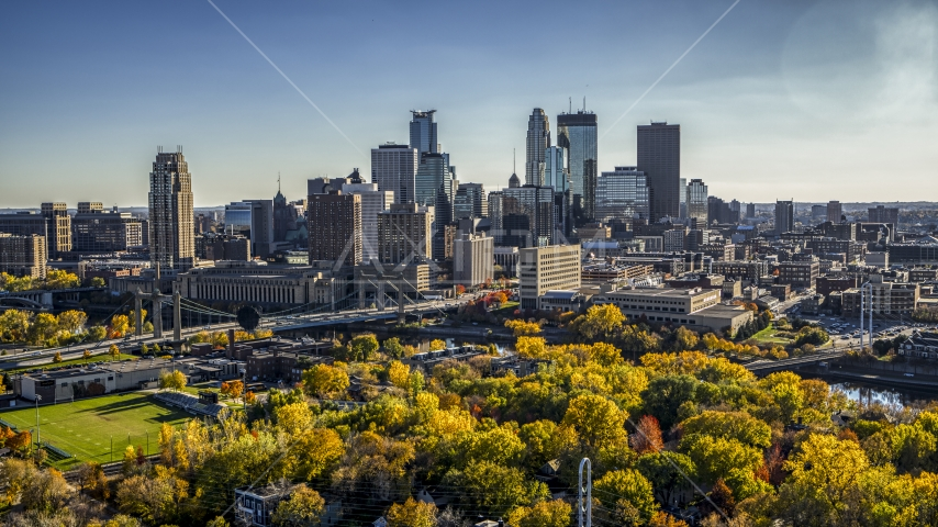 The towering skyline seen from a park by the river, Downtown Minneapolis, Minnesota Aerial Stock Photo DXP001_000410 | Axiom Images