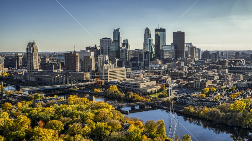 Bridges spanning the river near autumn trees, and the skyline in the background, Downtown Minneapolis, Minnesota Aerial Stock Photo DXP001_000411 | Axiom Images