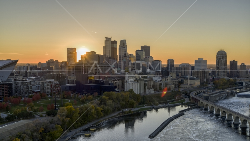 The city skyline on the other side of the river at sunset, seen from near a bridge, Downtown Minneapolis, Minnesota Aerial Stock Photo DXP001_000428 | Axiom Images