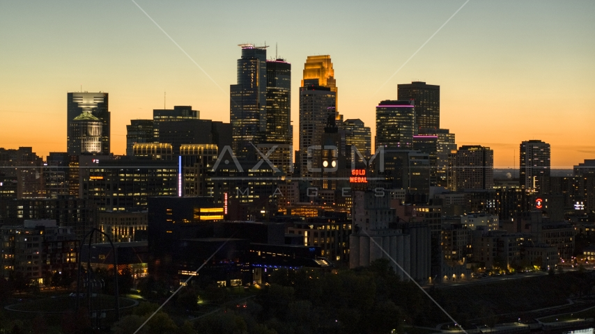 The skyscrapers in the downtown skyline lit up for the night at twilight, Downtown Minneapolis, Minnesota Aerial Stock Photo DXP001_000445 | Axiom Images