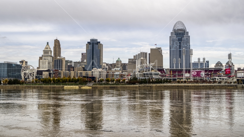 The city's skyline seen from low over the Ohio River, Downtown Cincinnati, Ohio Aerial Stock Photos DXP001_000448