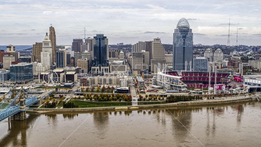 The city's skyline and baseball stadium by the Ohio River, Downtown Cincinnati, Ohio Aerial Stock Photos | DXP001_000451