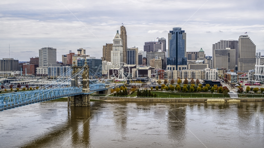 The city's skyline and Roebling Bridge spanning the Ohio River, Downtown Cincinnati, Ohio Aerial Stock Photos | DXP001_000452