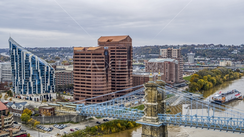 Condo complex and two office buildings beside the Roebling Bridge spanning Ohio River in Covington, Kentucky Aerial Stock Photos | DXP001_000464