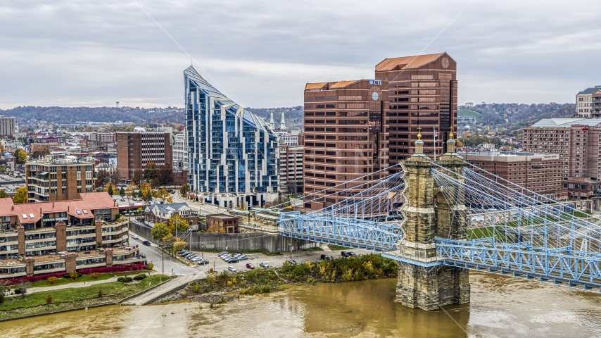 Condo complex and two office buildings behind the Roebling Bridge spanning Ohio River in Covington, Kentucky Aerial Stock Photos | DXP001_000466