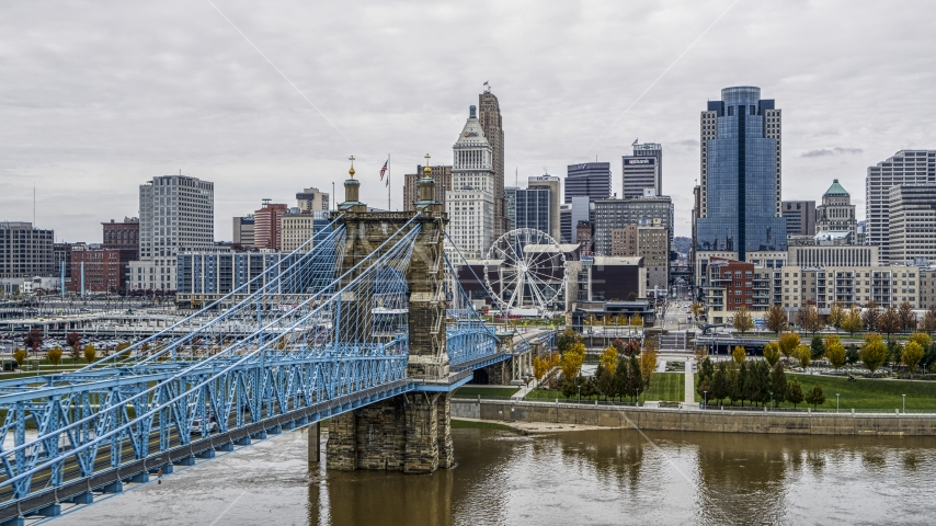 The side of the Roebling Bridge with Ferris wheel and skyline in the background, Downtown Cincinnati, Ohio Aerial Stock Photo DXP001_000471 | Axiom Images