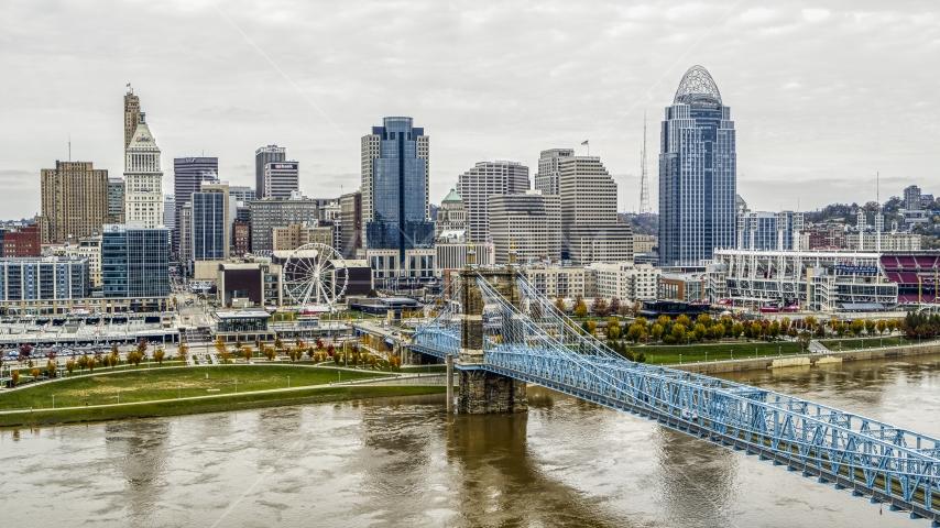 City's skyline and the Roebling Bridge across the Ohio River, Downtown Cincinnati, Ohio Aerial Stock Photo DXP001_000476 | Axiom Images