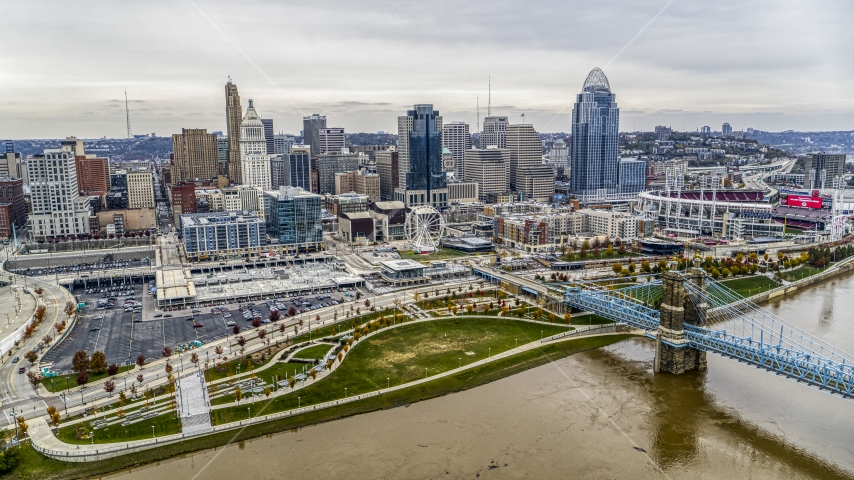 The city's skyline behind a riverfront park by the Ohio River in Downtown Cincinnati, Ohio Aerial Stock Photos | DXP001_000483