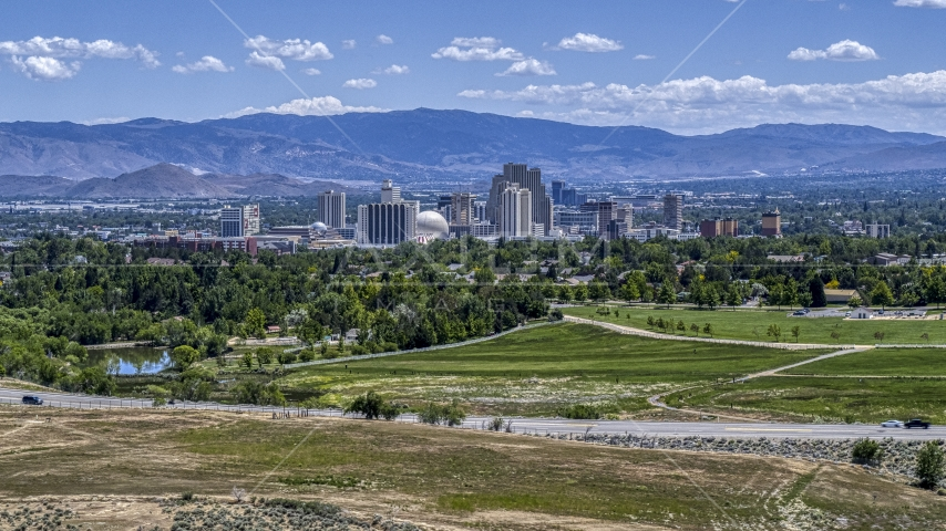 A wide view of the city's skyline in Reno, Nevada Aerial Stock Photos | DXP001_004_0001