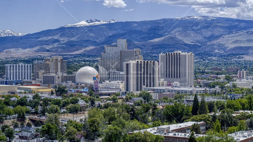 Resort hotels and casinos with mountains in the distance in Reno, Nevada Aerial Stock Photos | DXP001_004_0003